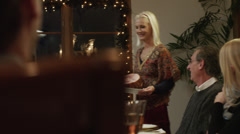 MS DS Family with children (2-5 months,2-9 years) having Christmas dinner / - stock footage