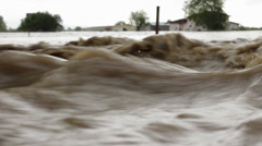Stock Video Footage of Waves close up. Flood river destroyed agricultural field after big rain storm.