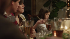 MS PAN Family with children (2-5 months,2-9 years) eating Christmas dinner / - stock footage
