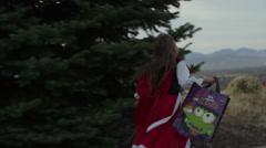 Tracking shot of running girl trick or treating / Cedar Hills, Utah, United Stock Footage
