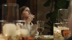 MS Girl (8-9) sitting at table and balancing spoon on nose / Cedar Stock Footage