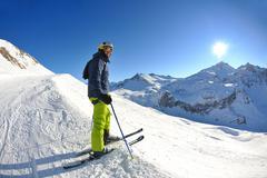 Skiing on fresh snow at winter season at beautiful sunny day Kuvituskuvat