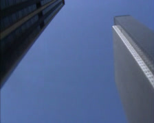 NEW YORK 1980s: low angle 380 view around skyscrapers + tilt down street Stock Footage
