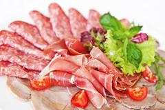 Assorted meat delicatessen Stock Photos