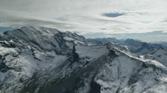 Wide shot/time lapse of snow covered mountain / Schilthorn Piz Gloria, Bern, Stock Footage