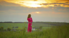 Young woman at the picturesque sunset background Stock Footage