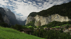 Wide shot/time lapse of remote village in mountain valley / Lauterbrunnan, Stock Footage