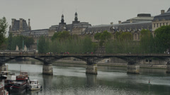 Medium shot of the Louvre and bridge / Paris, France Stock Footage