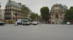 Time lapse/medium shot of traffic on city street / Paris, France Stock Footage
