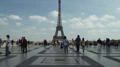 Slow motion/wide shot of tourists near the Eiffel Tower / Paris, France Stock Footage