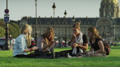 Slow motion close up of friends sitting on grass together / Paris, France - stock footage