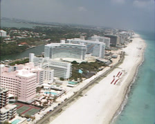 MIAMI BEACH - 1980s: aerial miami beach + hotels collins ave pinetree park Stock Footage