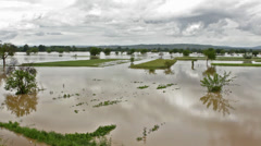 Murky river flooded countryside after big storm. Flooded agricultural fields. Stock Footage