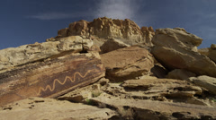Panning shot of drawing on rock formation at San Raphel Swell,  / San Raphel - stock footage
