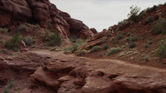 Medium shot, slow motion of woman running at Fisher Towers / Fisher Towers, Stock Footage