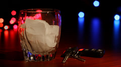 DUI Drunk Driving Glass and Keys Stock Footage