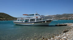 traditional Greek motor yacht for tourists transportation at Spinalonga island - stock footage
