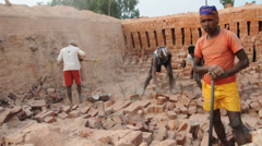 Bricks being made at an indian brickfield Stock Footage