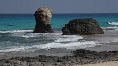 Waves on the rocks, turquoise water, Marsa Matruh, Egypt Stock Footage