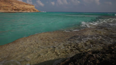 Waves on the rocks, turquoise water, Marsa Matruh, Egypt Stock Footage
