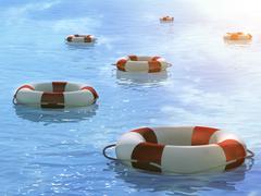 Lifebuoys, floating on waves - stock illustration