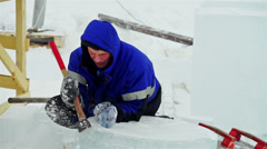 Sculptor working on ice figure with enthusiasm - stock footage