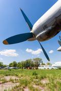 old russian turboprop aircraft at an abandoned aerodrome - stock photo