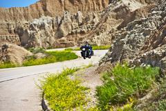 Scenic by way - travelers on a motorbike. bike trip thru badlands national pa Stock Photos