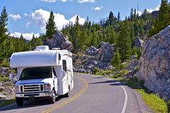 yellowstone rv trip. yellowstone national park is located primarily in the u. - stock photo