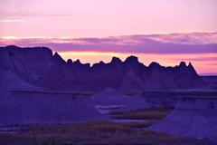 Badlands sandstones sunset. badlands formation during sunset. south dakota, u Stock Photos