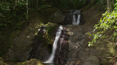 Panning medium shot of waterfall and stream / Esterillos, Costa Rica, Stock Footage