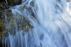 waterfalls closeup. rapidly running mountain stream water. nature photo colle - stock photo