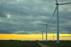 Wind generators sunset. wind turbines plantation. technology photo collection Stock Photos