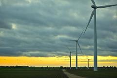 wind generators sunset. wind turbines plantation. technology photo collection - stock photo