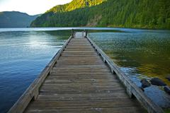 wood floating dock over crescent lake in the olympic national park, washingto - stock photo