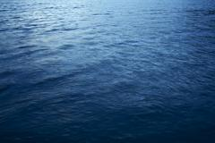 Lake blue water - lake crescent dark blue water photo background. Stock Photos
