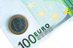 Stock Photo of 101 euros closeup. one hundred euros bill and one euro coin. business theme