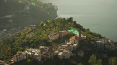 Stock Video Footage of WS HA PAN View of coastal cliffs with scattered houses / Ravello,Campania,Italy