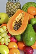 Fresh papaya slice and other fruits composition. vertical studio photo Stock Photos