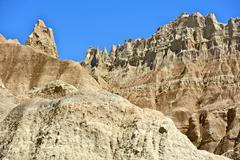 Badlands formations: sandstone spires and pinnacles - clear blue badlands sky Stock Photos