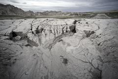 sandy badlands landscape at evening. badlands south dakota. eroded sandstones - stock photo