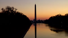Washington Monument in reflecting pool at Dawn Stock Footage