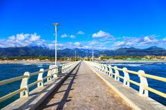 Stock Photo of pier, beach and apuane mountains in forte dei marmi versilia tuscany italy