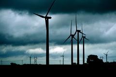 Wind turbines stormy theme. dark stormy theme with many wind turbines landsca Stock Photos