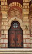 Church doorway with wooden doors and intricate metal hinges. Stock Photos
