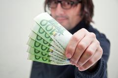 Man paying in euros Stock Photos