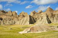 Stock Photo of summer in the badlands. the landscape of badlands national park is roughly ha