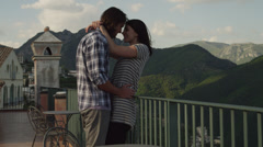 MS Couple embracing, standing by balustrade on balcony / Ravello,Campania,Italy - stock footage