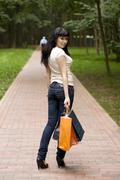 Brunet girl with shopping bags Stock Photos