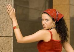 Stock Photo of pretty brunet woman  near column